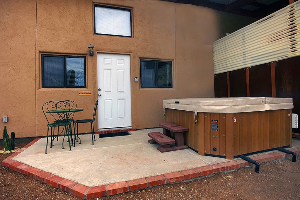 Private hot tub patio under the stars with private entrance.