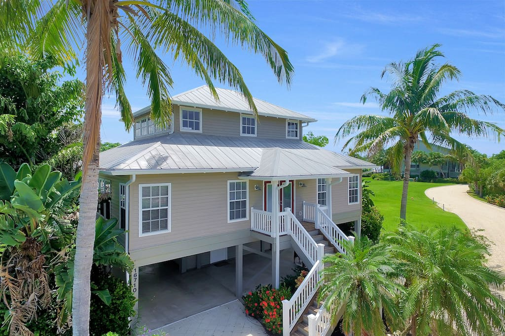 Old Florida style with lush tropical landscaping
