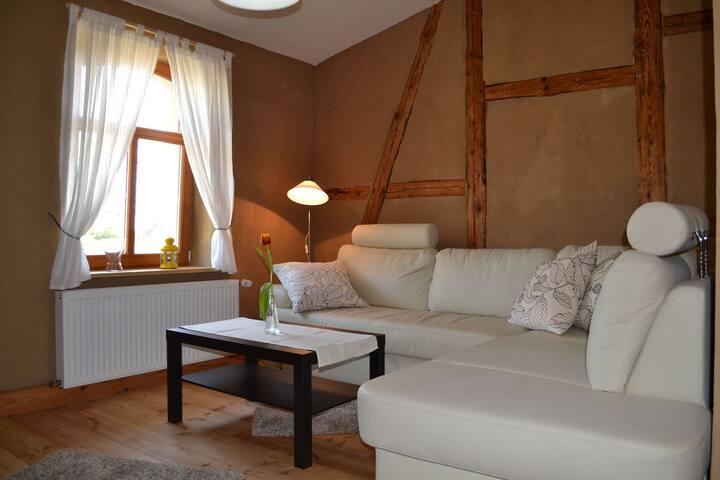 Rustically furnished three-room apartment on a farm