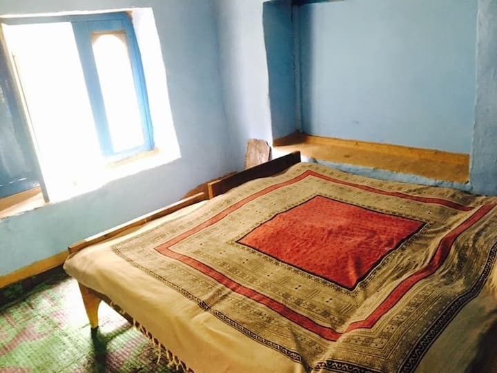 Budget double room with mud walls, shared balcony