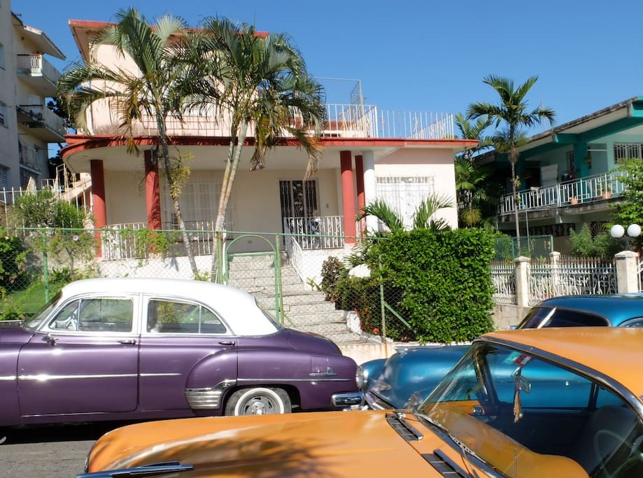 Front view of the house with some of the old cars cruising the streets of Havana