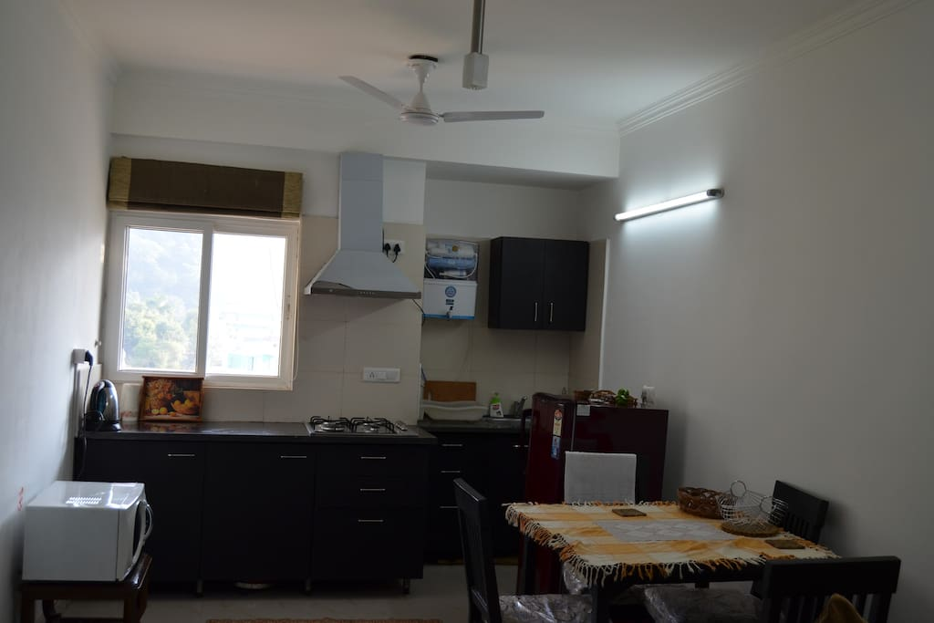 Kitchen with kitchenette,RO water purifier,Microwave Oven,Dining Table/4 Chairs,Refrigerator ,Chimney