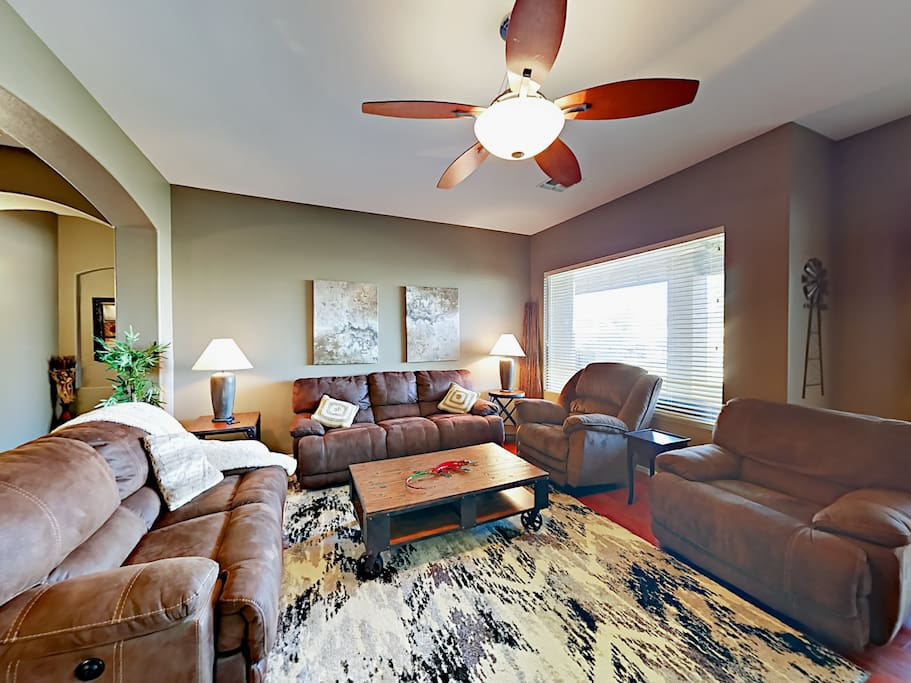 Living room with vaulted ceilings and plush seating for 7.