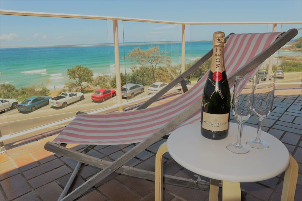 Enjoy a glass of bubbly as you watch the whales and dolphins play