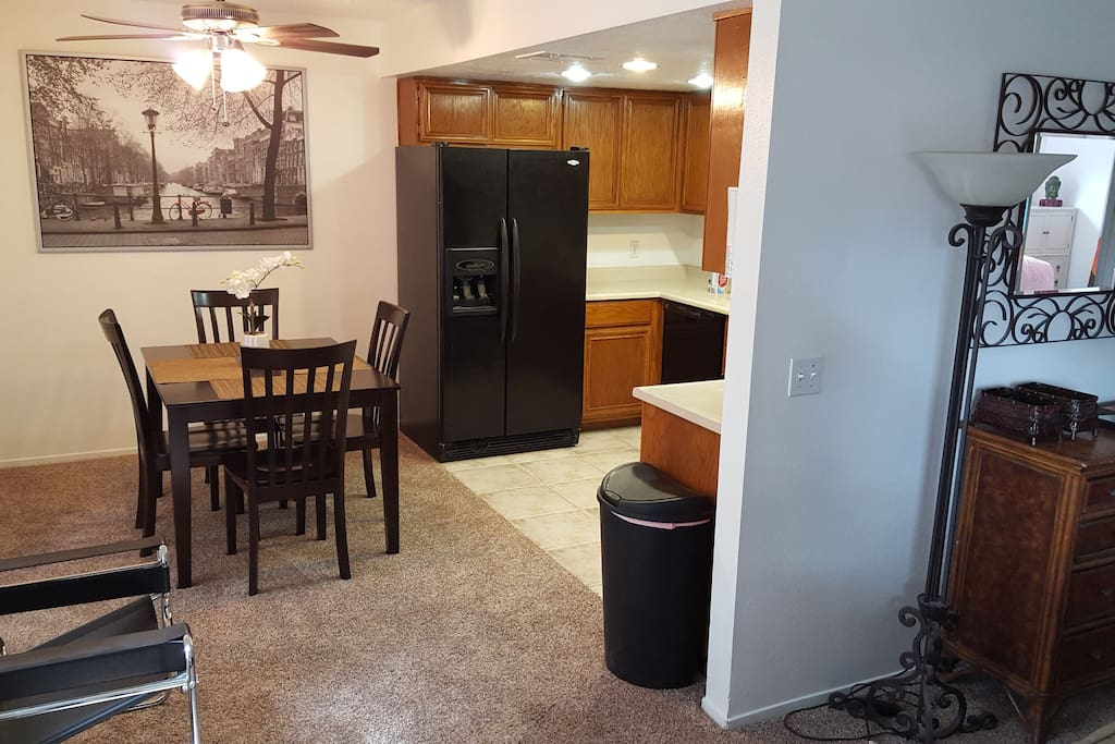 Modern furnishings are functional and pleasant. Ice maker and filtered water dispense from refrigerator.