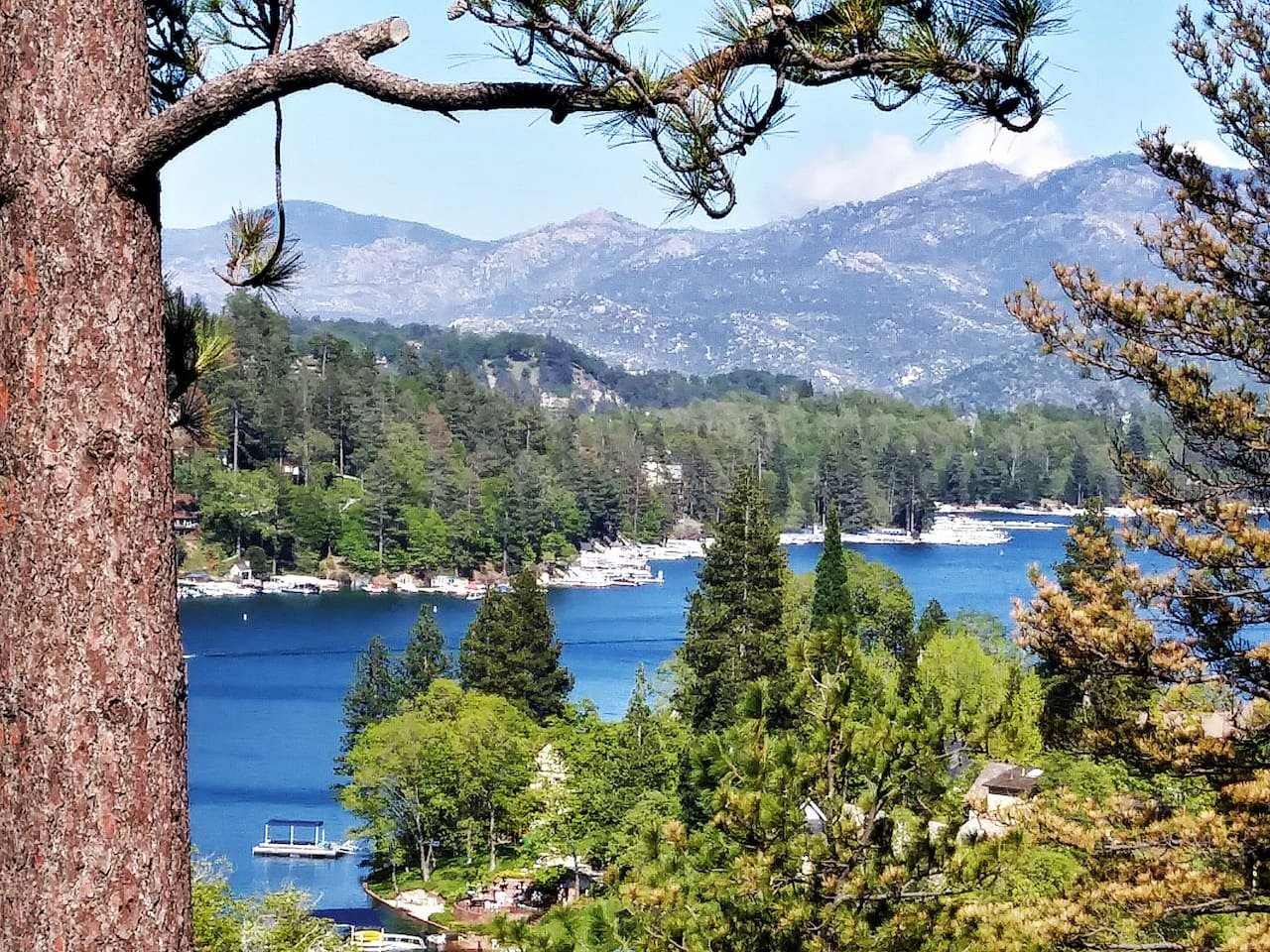 Front row seat view of beautiful Lake Arrowhead from our front deck. Watch all the activity. You can see our dock from the deck on the left side of the picture.