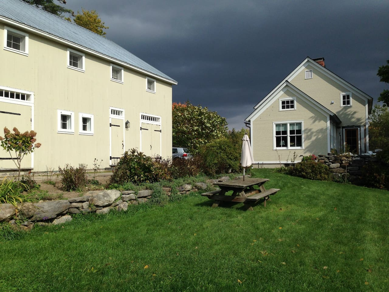 A blustery day in Vermont. Apartment is through center door in building on left.