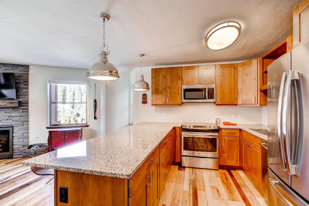 Kitchen is equipped with stainless appliances and tons of granite counter space! We have it stocked with everything you will need to prepare a family-style meal! Pots, Pans, Dishes, all the way down to the measuring spoons.