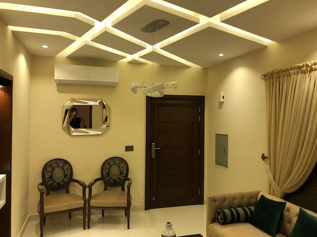 Feature chairs and designer sofa's with a very fine ceilings in all areas of the apartment