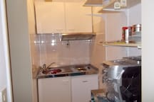 Own kitchenette with stove, refrigerator,microwave and coffee machine