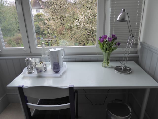 Ample space to use as a home-office, or just enjoy a relaxing cuppa while admiring the garden.