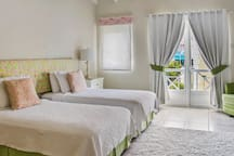 This is the twin room, has a Juliet balcony over looking the gardens and Rodney Bay. Twin beds can be pushed together to make a King.