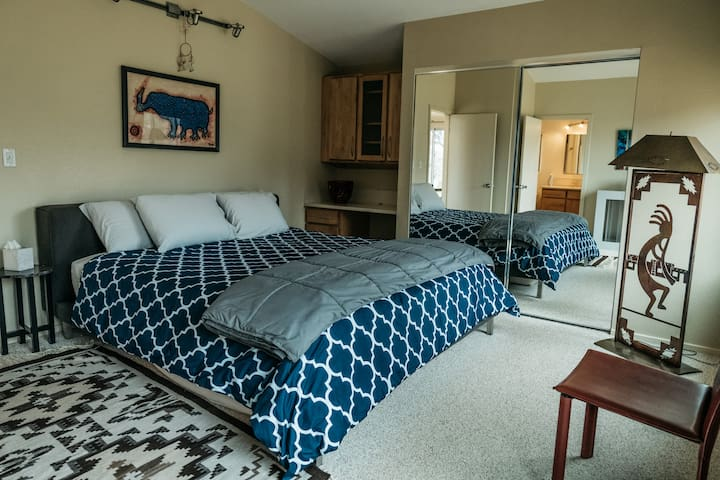 Spacious master bedroom has a king bed