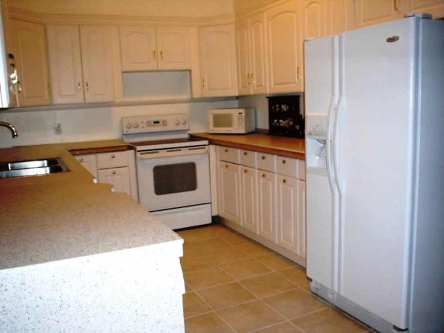Kitchen with granite counter tops, and all necessities