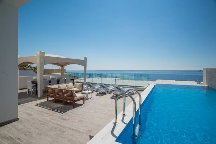 Ultra Modern sea front villa with private pool