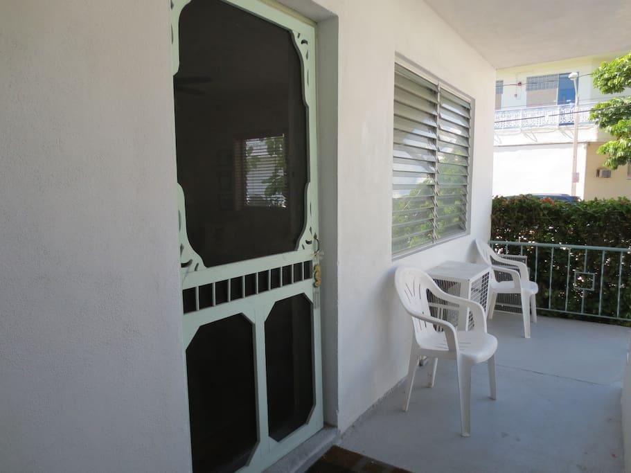 Screen door & outdoor sitting area.