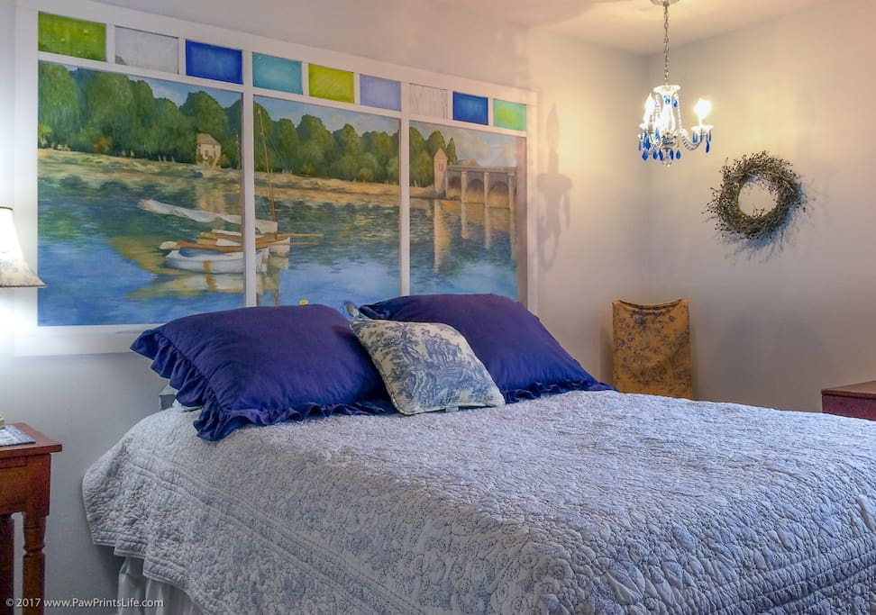 Our Monet Room. It's pictured here with a queen bed, but it now has a double. Notice the hand-painted mural, based on a Monet painting.