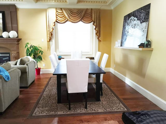 Elegant dining room.  Table can extend out further, and there are additional chairs available.