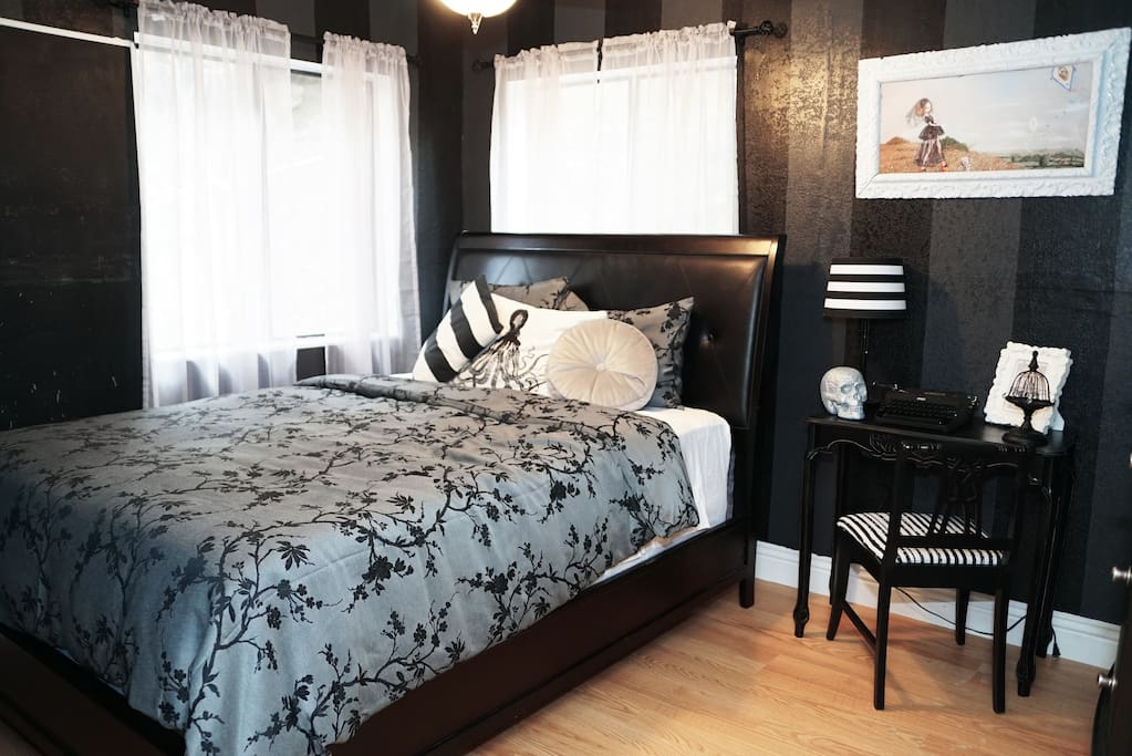 """Gothic"" bedroom with queen bed"