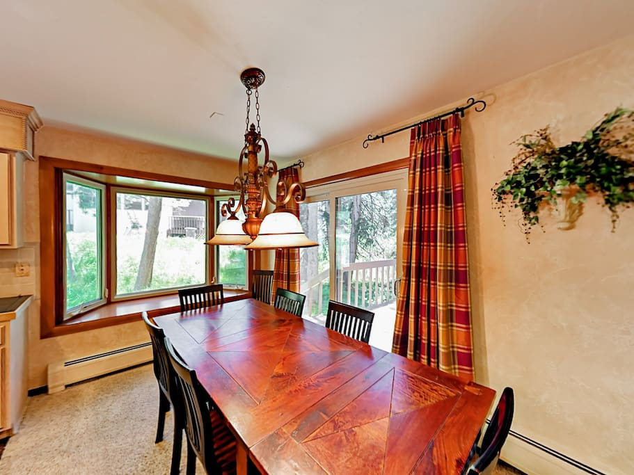 Gather at the 8-person dining table for intimate family meals.