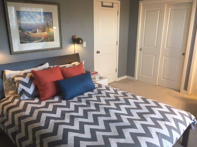 Extra pillows, medium weight comforter, side tables