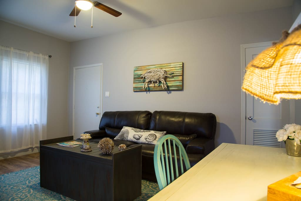 Highlights our GALVESTON Island artwork and design, as well as our leather touch recline sofa.