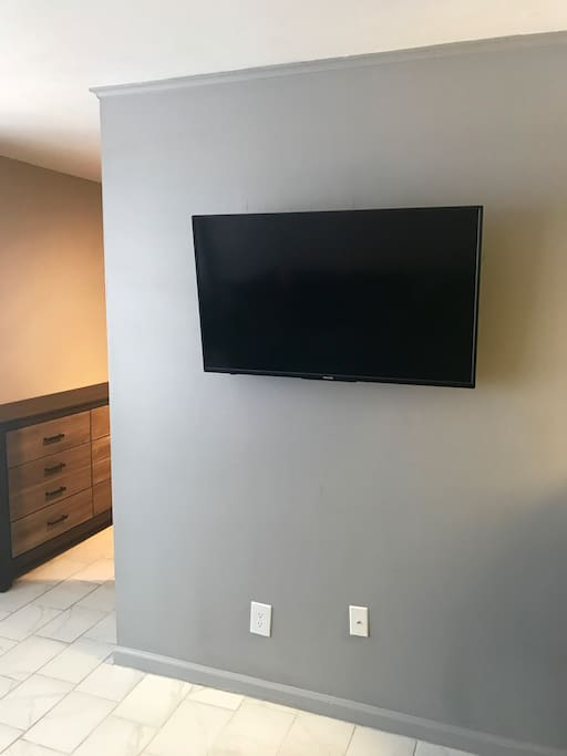 """A 40"""" TV in the living room with Netflix."""