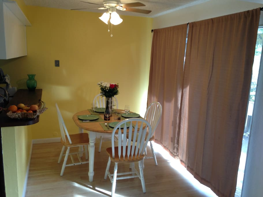 Dining nook/room of the kitchen. Curtains block morning sun, or let in morning sun.