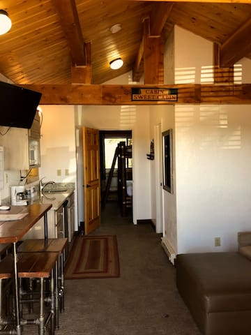 View from the front door through the cabin and into the back bedroom.