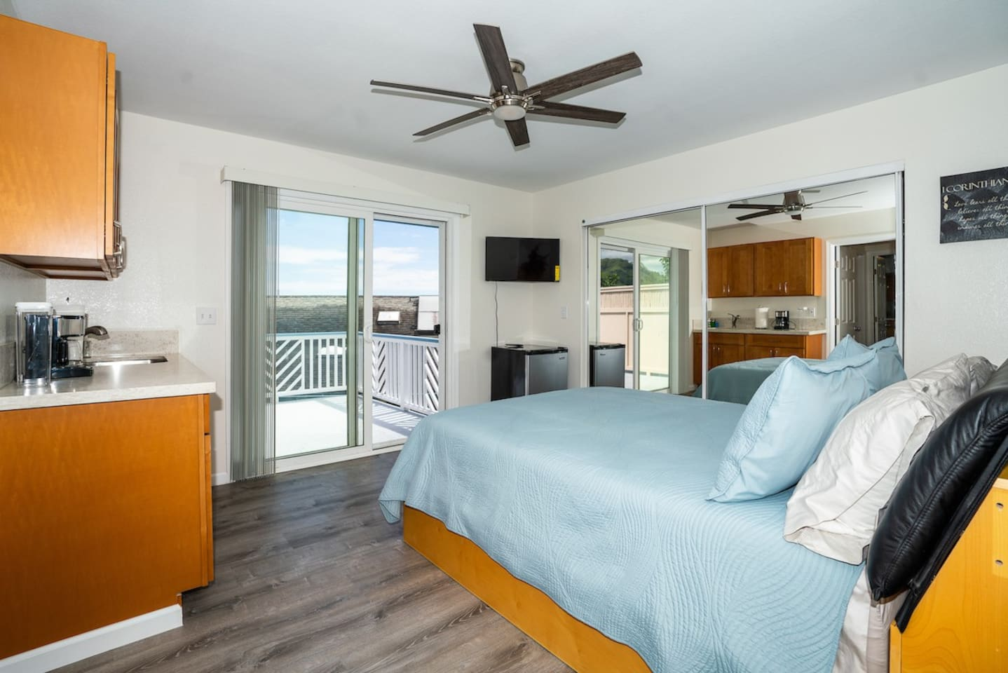 Room 4 with queen size bed, AC, full wet-bar & private lanai.