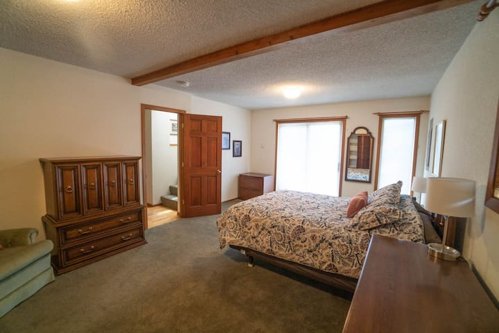 The master bedroom is on the main level with direct access to the deck.