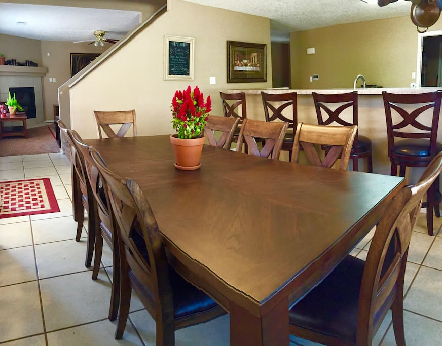 The dining room features a solid wood table and seating for up to 12 people.