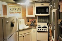Kitchen, all new construction, with locally sourced antiques.  Coffee maker and all appliances plus eco-friendly soap.  We provide organic, coffee for our guest's stay.  We have a locally sourced food item for your arrival to welcome you.
