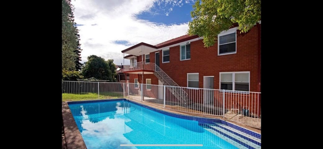 Convenient Location with Large Pool
