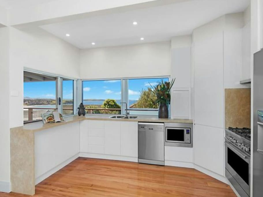 New well equipped kitchen, overlooking the ocean.