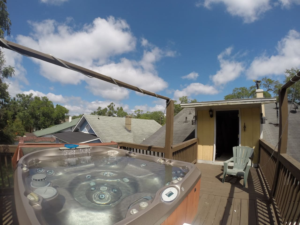 large hot tub, fits 6 comfortably seats 8 people, walk out to the tub from the movie room upstairs