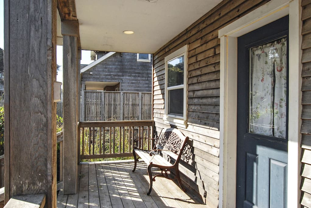 Front porch with small bench