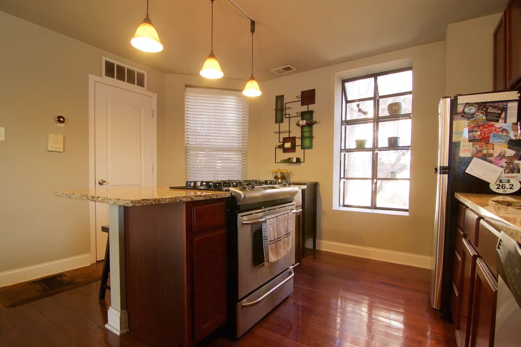 Kitchen:  Beautiful cherry cabinets and flooring along with granite countertops and stainless steel appliances.  Refrigerator, oven/stove, dishwasher, microwave, and keurig.