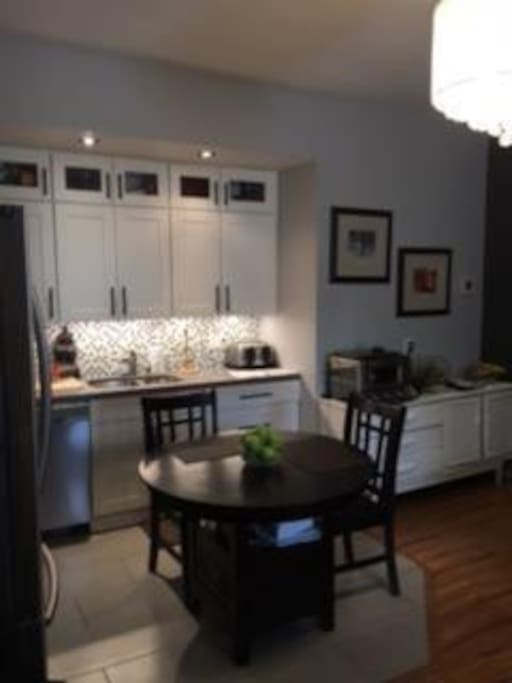 Modern Kitchen opens to dining area