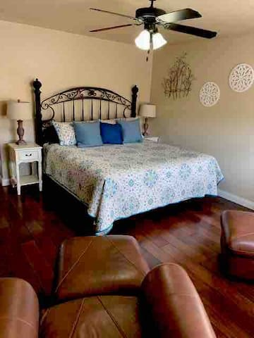 Master bedroom has King bed, nice chest of drawers, walk-in closet, leather chairs and fully stocked bathroom.