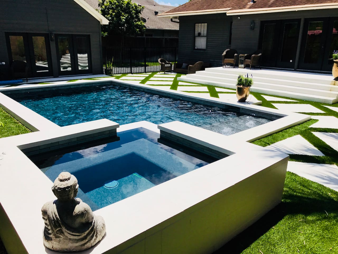 Pool \ Guest House to the left on second floor with view and small patio overlooking the pool and hot tub