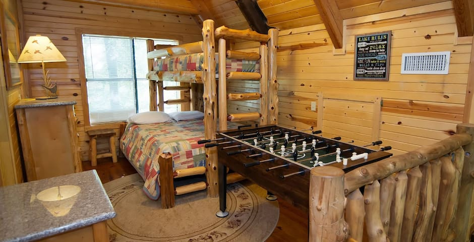 Loft Bedroom has a Bunk Bed with a Queen on Botton and a Twin on Top and a Foosball Table.