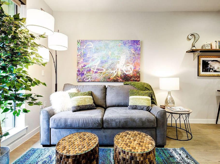 The living room gets lots of natural light, and has comfy sleeper sofa.