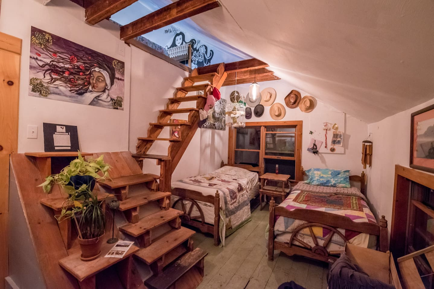 The loft bedroom has two single beds on the first floor, and a full-size bed up stairs in the open-floor layout.