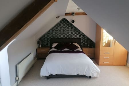 Modern double room in a family home.