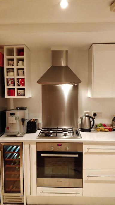 Kitchen with gas stove and bean to cup espresso machine