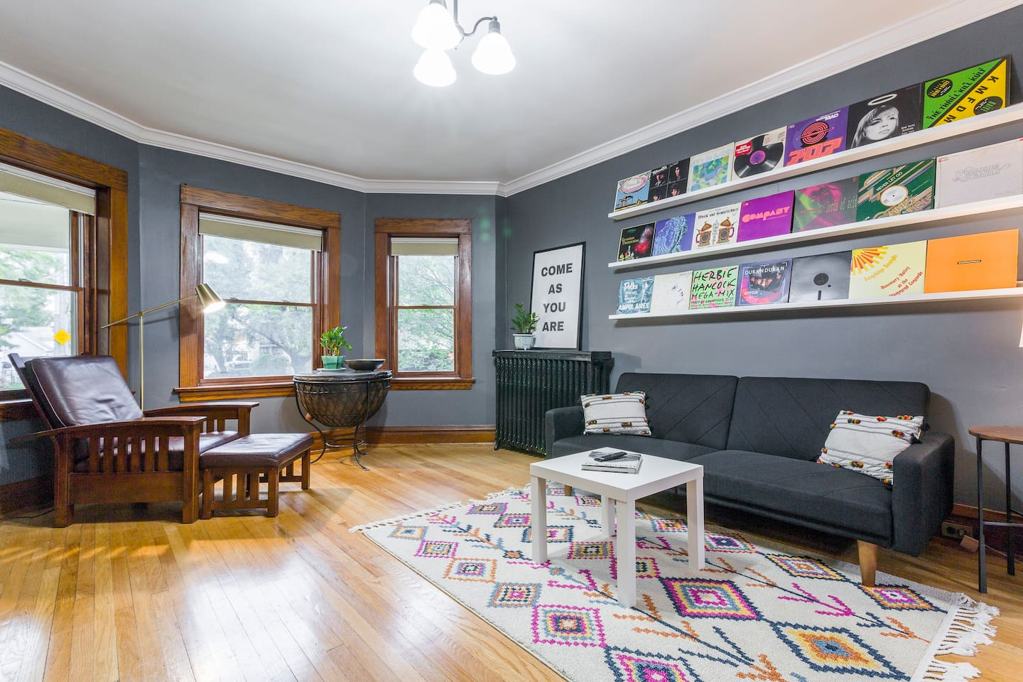 The living room has a comfortable leather chair with big windows, letting in tons of sunshine for reading.  The couch converts to a bed- just let us know if you need it!
