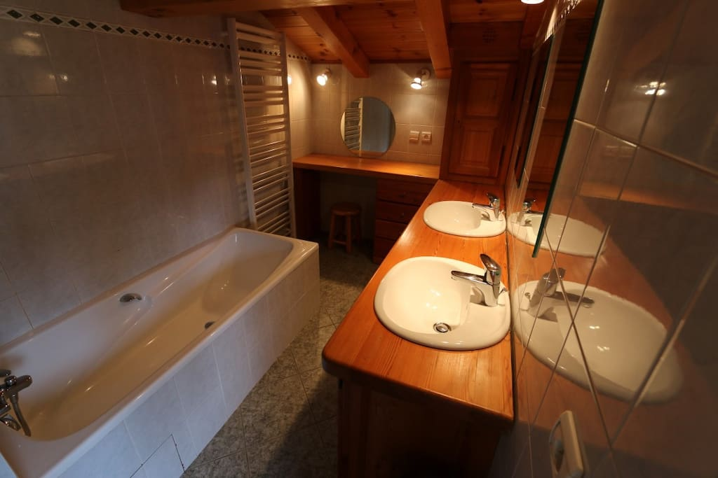 Top bathroom with bath, shower and twin basins