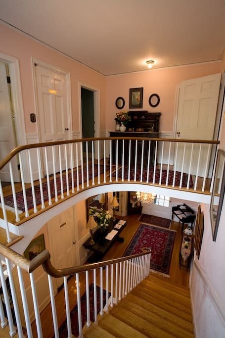 View of our staircase and lobby from the second floor landing!