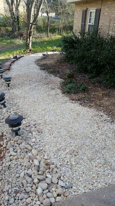 Pebble walkway to entryway.